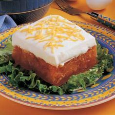 "A sweet, creamy topping frosts this extra-fruity gelatin that is chock-full of canned apricots and crushed pineapple. ""It's a colorful salad to serve at potluck dinners and is always a hit! (you can substitute a Cool Whip type frosting or the topping) Pineapple Jello, Orange Jello, Crushed Pineapple, Cool Whip, Jello With Fruit, Strawberry Jello, Congealed Salad, Jello Recipes, Salad Recipes"