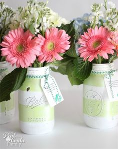 Give the gift of fresh flowers in a cute DIY painted mason jar vase. With some simple stripes and your favorite paint, you can transform plain jars into cute home decor.
