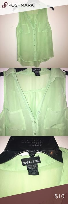 Mint green sheer tank top Mint green sheer tank top w buttons down the shirt, 2 pockets on the top— note: loose threading on one of the pockets on the inside, can't be noticed unless it's pointed out— worn a handful of times Wet Seal Tops Blouses