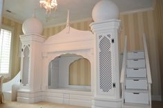 Amazing child's bedroom with a middle eastern flair. Features a bunk bed, staircase, storage and a slide.