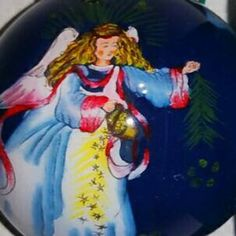 Christmas Angel flying on a  gilded four inch ball 2006 Li Bien hand painted glass collectible ornament Keepsake for the future.