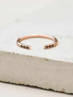 We're taking our eternity bands to a new level. This ring is a minimalistic take on our best-selling eternity band. The ring features six black cubic zirconia stones set on a very thin round band. The
