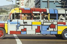 """TV's Partridge Family throws caution to the wind as they travel sans seatbelts in their wildly painted bus. This scene is from the episode """"What? And Get Out of Show Business?"""" Crazy, man."""