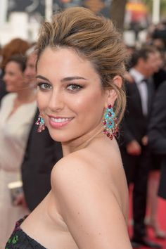 May 2015 - Sparkling in Cannes | Spanish actress Blanca Suárez wearing Chopard's Red Carpet Collection: chandelier earrings w/ rubellite, turquoise, diamonds & tsavorites.