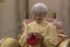"Sophia (Estelle Getty) is making a bottle cover for the sherry she drinks in the park. Is more discreet than a paper bag. ""Golden girls"""