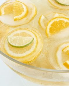 Party punch calls for festive ice: giant frozen cubes capturing bright slices of fresh citrus. To make the ice, thinly slice lemons, limes, and oranges, and layer the slices in muffin cups. Fill each cup halfway with water or nonalcoholic punch, and freeze.