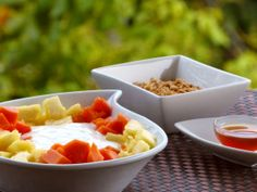 Breakfast - healthy start with joghurt, granola and fresh fruits.