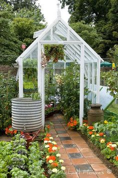 with Flagstones Greenhouse in the backyard.I want the rain barrel with spigot!Greenhouse in the backyard.I want the rain barrel with spigot! Backyard Greenhouse, Greenhouse Plans, Small Greenhouse, Greenhouse Wedding, Window Greenhouse, Greenhouse Growing, Shed Design, Garden Design, Garden Cottage