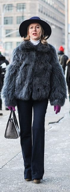 Natalie Joos furry coat and colore gloves - Street Style at New York Fashion Week