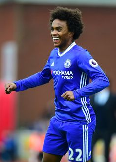 Willian of Chelsea celebrates scoring his sides first goal during the Premier League match between Stoke City and Chelsea at Bet365 Stadium on March 18, 2017 in Stoke on Trent, England.