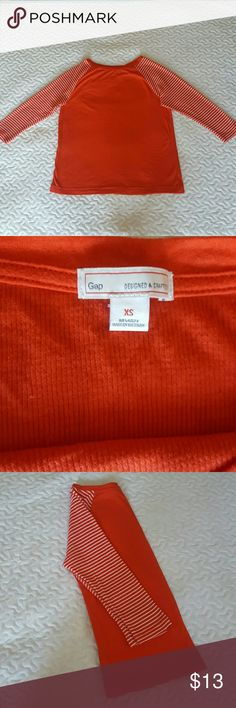 Gap T shirt Comfortable red tshirt with 3/4th sleeves. size says xs but it will fit someone who wears small as well.Due to light color looks little bright however its a red color t shirt. In execellent condition. GAP Tops Tees - Long Sleeve