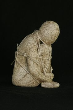 Tied Up in Knots is a O.O.A.K. (one of a kind) small female figurative sculpture made from polymer clay completely wrapped in knotted twine