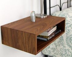 This Mid-Century Modern inspired floating nightstand is built from solid American Black Walnut and mounts easily to your wall using an integrated French cleat.   Each piece is hand built in Maine from solid hardwood planks joined with a 45 degree miter creating a beautiful wrap-around continuous grain.