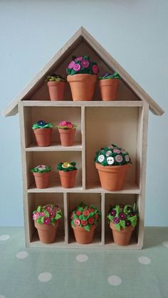 Miniature felt and button plants in display shelf