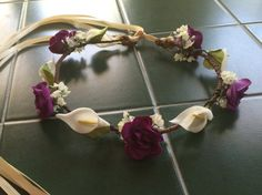 Visit my store at www.just4uBowsandFlowers.Etsy.com to see more halos, bun wraps, pew bows, pomanders, corsages and more.  This is a custom made dainty woodland calla lily crown made with your choice of up to 2 ribbon colors, mini roses and a touch of silk babys breath. The halo is available in all sizes from infant to adult. Please let me know age when ordering so I know how large to make this.  Roses are available in white, ivory, deep red, pastel pink, pink with leaves, dark blue, deep…