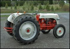 (8N Ford Tractor) My Paw Paw had one of these tractors they always remind me of when I was small, I use to pitch a fit to ride with him then would fall asleep within five minutes of riding. He probably wanted to kill but that's okay!!!
