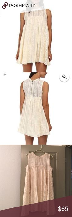 FREE PEOPLE Tu Es La Mini dress - Ivory M Free People Tu Es La Mini - Women's Dress : Ivory Combo : Fabulous trapeze dress is fabricated from allover lace and features raw-cut trim. High neckline and sleeveless construction. Zip closure at back. Flared hemline falls at a flirty length. Fully lined. 73% cotton, 27% nylon; Lining: 100% rayon.                  Size Medium Perfect condition - worn twice! Free People Dresses Mini