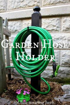 Deck Post + Equestrian Hook = While Wearing Heels: DIY Garden Hose Holder