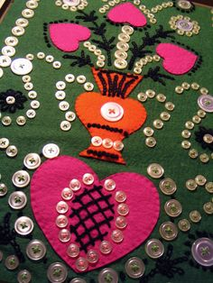 """Thrift store button art."" Most crafts that involve felt and embroidery look like fun to me!"