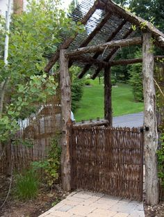 Custom Arbor Incorporating Rustic Willow Fencing As Roof And Gate Into  Backyard From Driveway. Rustic