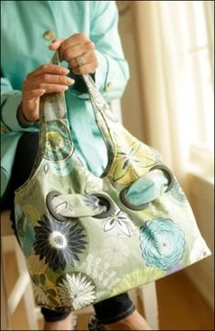 "Paper sewing pattern for an easy to make bag. Cinch it in with decorative grommets on the short version or show off your quilting skills on the large market bag. Short Bag: 9 ½"" H x 13 ½"" W x 6 ½"" D."