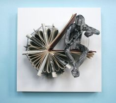 Thinker with Needle by Kenjio. Clay sculpture and a cut book mounted on a Claybord panel