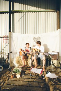 acoustic tunes from the groom on our homemade pallet wood stage stuffed with straw! nik & chris | an eco-friendly, handmade coastal welsh wedding » Home