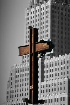 The intersecting steel beams were found in the rubble of buildings destroyed in the September 11 attacks on the World Trade Center. Always remember 9/11.  Sad...Atheists tried to sue to stop the display of the 9/11 cross at NYC memorial