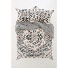 Magical Thinking Kasbah Worn Carpet Comforter ($149) ❤ liked on Polyvore featuring home, bed & bath, bedding, comforters, cotton bedding, floral comforters, cotton comforter, reversible bedding and reversible comforter