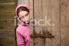 Girl peeking behind the door royalty-free stock photo