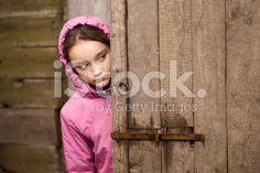 Girl peeking behind the door royalty-free stock photo