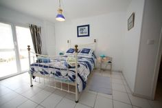double bedroom on ground floor with en suite bathroom & French doors out to the veranda out front