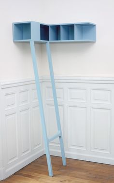 Corner Shelf emphasizes the corner, a significant space in the house (a meeting between two planes, a boundary). Objects can be hidden or shown according to their place in the shelf. The one stepladder enables a quick and easy access to skim through a book.