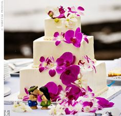 Vanessa and Ross knew they wanted a simple cake for their wedding day, so they had theirs decorated with fuchsia dendrobium orchids that matched Vanessa's bouquet.