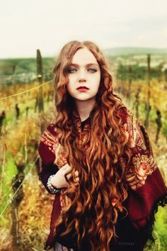 Copper curls. I love the curls and the length of that hair. So pretty!
