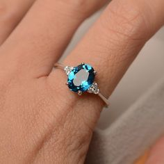 This ring features a 7mm*9mm oval cut genuine London blue topaz and sterling silver finished with rhodium. Customization is available. It is made by hand, and it will take about 7 days to finish the ring after your payment is completed. Main stone: London blue topaz London blue topaz