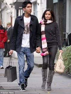 Slumdog Millionaire stars Dev Patel and Freida Pinto, look every inch the happy couple as they walk arm in arm around Central London