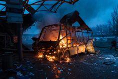 """https://flic.kr/p/vPwHbu   Обстрел автостанции """"Центр""""   Приблизительно в 7.30 утра был обстрелян хим завод и автостанция, в результате чего, водитель сгорел на месте, один человек скончался по дороге в больницу, несколько раненых.  Донецк, 11 февраля 2015."""