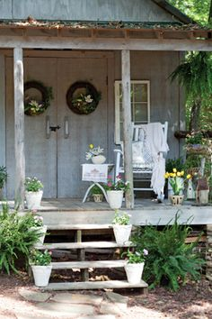 Dainty touches such as flowers and linens turn this cottage porch into a canvas for celebrating spring.