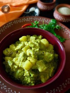 A creamy Odia style curry of ridge gourd and potatoes made from poppy seeds paste.