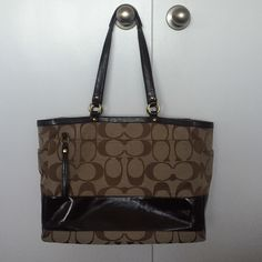 Coach Signature Stripe Baby Bag EEUC Signature stripe baby bag.  Tons of pockets in this bag!  2 inside zipper pockets, 1 outside zipper pocket, 7 pockets around the inside of the bag.  Extremely clean only very mild wear on the bottom corners. Come with dust bag!  Never used as a diaper bag, I carried my laptop in here. Coach Bags Baby Bags