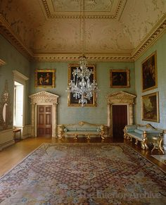 The sofas in the drawing room, with their rococo feet, were based on a design by Robert Adam and built by John Linnell