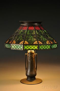 Metal Overlay Table Lamp  Slag glass and patinated metal  United States, early 20th century Shade not original to base.