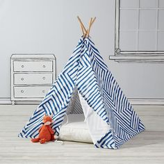 Everyone needs a little space just for themselves. This geometric kids teepee is the perfect home away from home while trailblazing the playroom frontier. Plus, it was designed by just for us by Ampersand Design Studio.