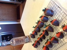 Double chocolate vodka infused strawberries dipped in melted chocolate!  Soak strawberries in chocolate flavored vodka for 24 hours (the 360 brand is my favorite), gently dry with a paper towel, melt chocolate (I used Almond Bark)' dip into chocolate, let the chocolate dry, then eat!  (Don't let your kids eat them).