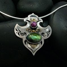 """""""Wings of Time""""  One of a kind Labradorite and Star Ruby Pendant 22k Gold and Sterling Silver  Made with love!  www.melissacaron.com"""