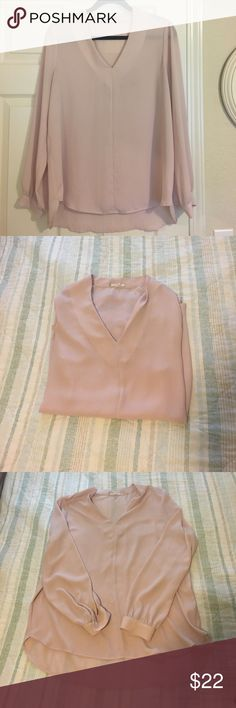 """Pleione blouse Pleione v-neck long sleeved blouse in excellent used condition. Light pink/rose color. Button closure on sleeves. 100% polyester. Back hem slightly longer than front. 26"""" front shoulder to hem, 29"""" back shoulder to hem. Pleione Tops Blouses"""