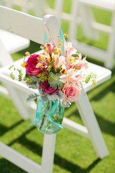 DIY Beach Wedding // beautiful and beachy flowers hanging in mason jars for the ceremony... // image: Jennifer Wilson Photography
