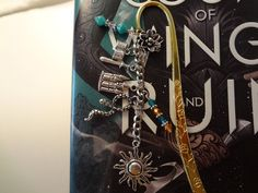 A Court of Thorns and Roses Inspired Metal Bookmark, Helion/Day Court Edition by TheWorldOfFandom on Etsy