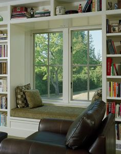 lovely window seat. Something like this built into the side of the stairs?